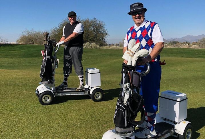 Golfers on motor scooters at Longbow Golf Course in Mesa, Arizona.