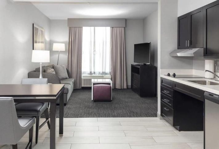An extended stay hotel room with a kitchen at the Homewood Suites by Hilton in Largo .