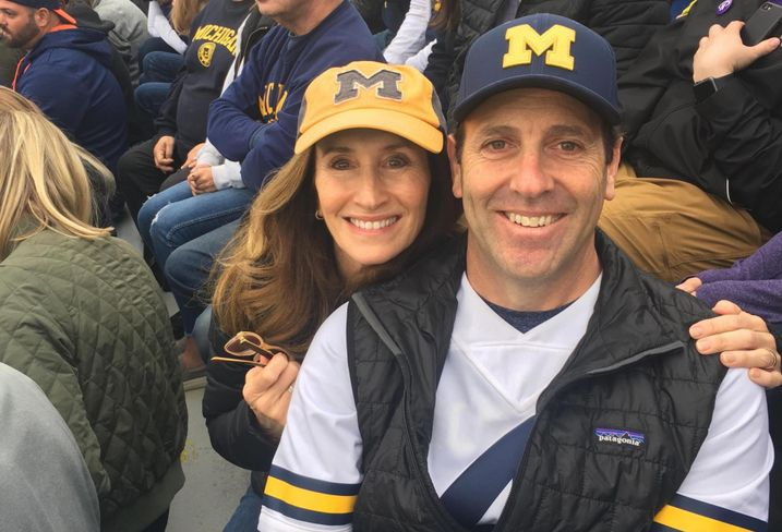 Lowe Executive Vice President, Retail Joel Mayer with wife Julie Mayer at a University of Michigan football game