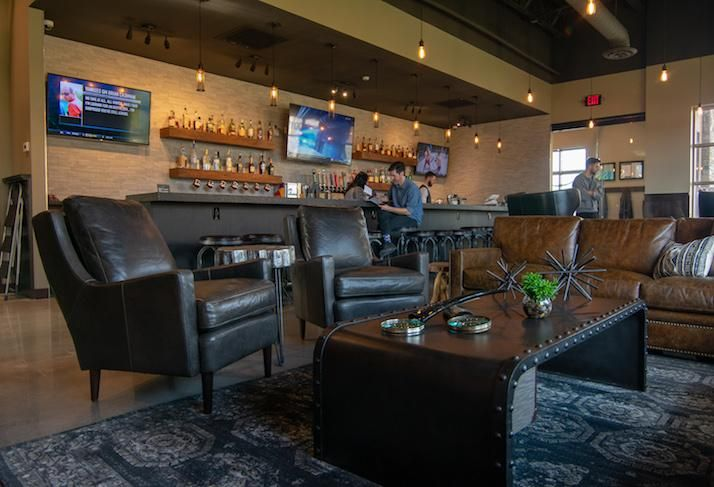 The bar and lounge area in Scissors & Scotch's Overland Park, Kansas location.