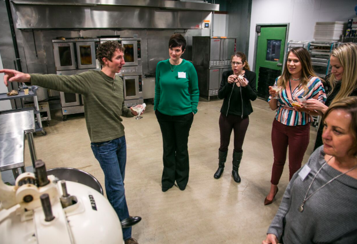Kirk Francis, founder of Tastemakers and founder/co-owner of Captain Cookie and the Milk Man provides guests with a tour of the new Tastemakers facility.