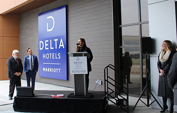 Stacy Martin, Managing Director of the Delta Hotel by Marriott Dallas Allen & Watters Creek Convention Center speaks at the ribbon cutting of the first Delta Hotels hotel in the Dallas area.