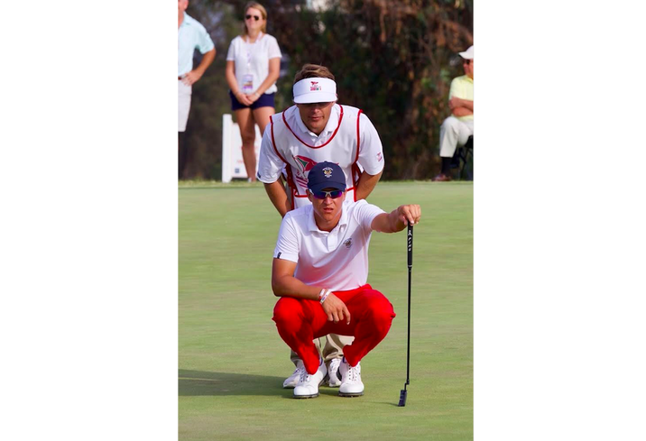 Bushnell caddying for Cameron Champ in the 2017 Walker Cup at Los Angeles Country Club