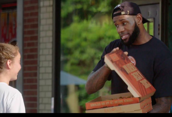 LeBron James delivers pizza in Akron, Ohio, in a commercial for Blaze Pizza, the chain he co-owns.