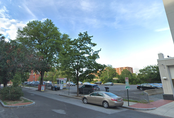 The surface parking lot at 811 Third St. NW, where a nine-story apartment building is planned