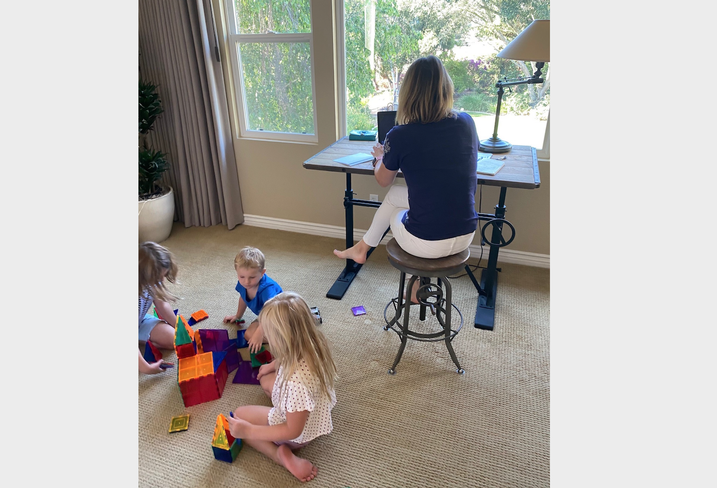 Lightbox Senior Vice President, Broker Operations Tina Lichens works from home while her children play in the room