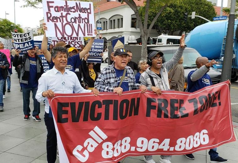 Protestors gathered in front of Blackstone Group's office in Santa Monica in support of a ballot initiative that would repeal Costa Hawkins Rental Housing Act.