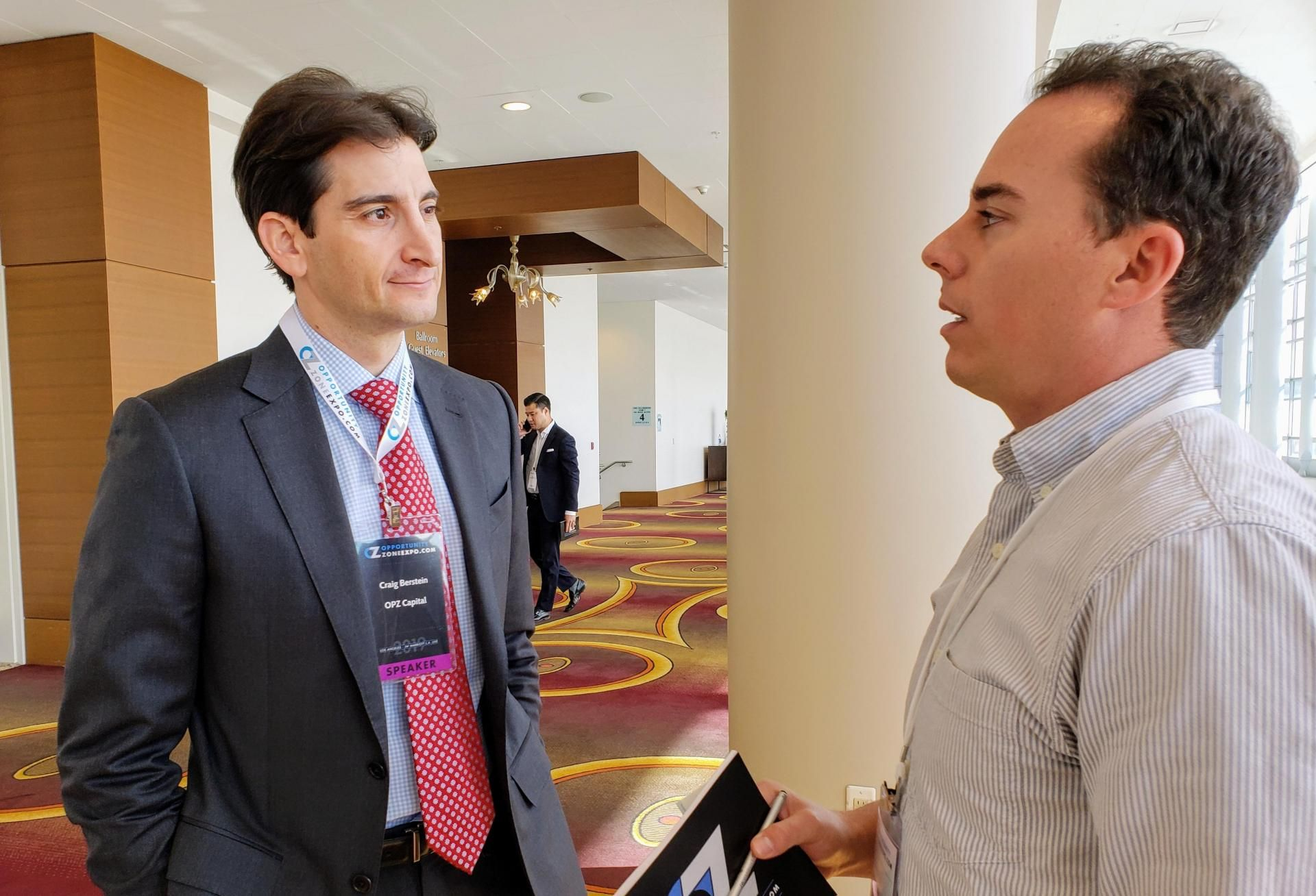 OPZ Bernstein principal Craig Bernstein (left) talks to an attendee at an opportunity zone event in Los Angeles